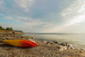 Kayaks on the ocean shore Royalty Free Stock Photo