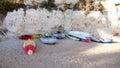 Kayaks and pontoons at the beach Stock Image