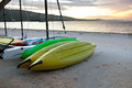 Kayaks on sand on seashore Royalty Free Stock Photo