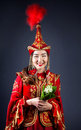 Kazakh women with flowers woman in red national costume holding bouquet of flower at grey background Stock Photos