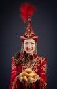 Kazakh women with national food woman in red costume holding plate baursak bread at nauryz celebration Royalty Free Stock Photo