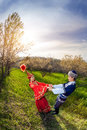 Kazakh young couple women in red dress dancing with men in spring apple garden in almaty kazakhstan central asia Stock Photos