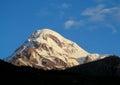 Kazbek mountain covered with snow in Caucasian mountains in Georgia Royalty Free Stock Photo