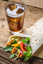 Kebab with fresh vegetables and chicken on old wooden table Stock Photography