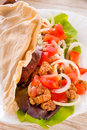Kebab grilled meat bread vegetables Royalty Free Stock Photos