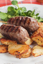 Kebab minced meat skewer grilled turkish with roasted potato Stock Images