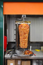 Kebab rotisserie meat at vertical grill Stock Photo