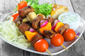 Kebabs on Plate with Mustard, Veggies and Bread Royalty Free Stock Photo