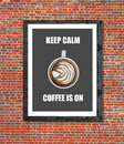 Keep calm coffee is on written in picture frame