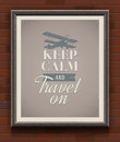 Keep calm and travel on vintage poster with quote in wooden frame a brick wall Stock Photo