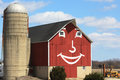 Keep those farmers happy a smiling red barn depicts either at the start of the growing season or after the season has ended Royalty Free Stock Photo