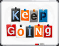 Keep going made from newspaper letters attached to a whiteboard or noticeboard with magnets. Marker pen. Vector. Royalty Free Stock Photo