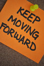 Keep Moving Forward Note on Pinboard Royalty Free Stock Photo