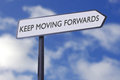 Keep moving forwards motivational street sign Royalty Free Stock Image