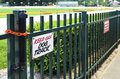 Keep off dog track sign on the green fence Stock Photos