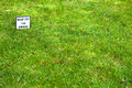 Keep off the grass green lawn with notice Royalty Free Stock Image