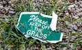 Keep off the grass, landscaping sign. Royalty Free Stock Photo