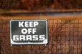 Keep off grass outdoor warning sign in nature area to the Royalty Free Stock Image