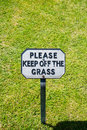 Keep off the grass polite notice saying please Royalty Free Stock Photo