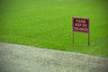 Keep off the grass sign on a football pitch Royalty Free Stock Photography