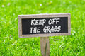 Keep off the grass sign on a green lawn Stock Image