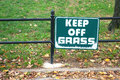 Keep off the grass a sign in new york city that reads Royalty Free Stock Image