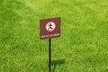 Keep off the grass sign in park Royalty Free Stock Images