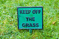 Keep off the grass signpost sign in close up Stock Images