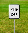 Keep off sign on the green lawn Stock Image