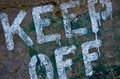 Keep off sign painted on concrete in cape may new jersey Royalty Free Stock Photography