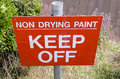 Keep off sign saying non drying paint england uk Royalty Free Stock Photography