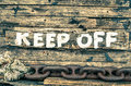 Keep off sign wooden painted background vintage filtered look Royalty Free Stock Photos