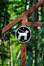 A keep pets on a leash sign on a wooden post Royalty Free Stock Photo