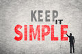 Keep it simple asian businessman write text on wall Stock Photo