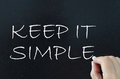 Keep it simple hand written on a blackboard Royalty Free Stock Photography