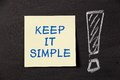 Keep it simple note with big exclamation mark on blackboard Royalty Free Stock Photo