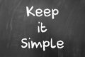 Keep it simple quote written with white chalk on blackboard Royalty Free Stock Image