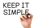 Keep it simple written by black marker isolated on white background Royalty Free Stock Photos