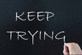 Keep trying hand written on a chalkboard Royalty Free Stock Images