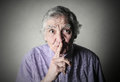 Keeping silence portrait of elderly man with gesture of Royalty Free Stock Photo