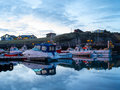 Keflavik boats along the pier in south western iceland Stock Photo