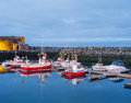 Keflavik boats along the pier in south western iceland Stock Image