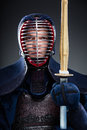 Kendo fighter with wooden sword portrait of kendoka japanese martial art of fighting Royalty Free Stock Photo