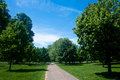 Kensington gardens in london tranquil pathway surrounded by luxuriant vegetation and trees hyde park Royalty Free Stock Photography
