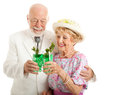 Kentucky derby day juleps southern senior couple enjoying traditional mint julep coctails to celebrate the isolated on white Stock Photo