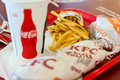 Kentucky fried chicken restaurant menu bucharest romania june with hamburger twister hamburger coca cola drink and chips kfc Stock Photo