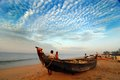 Kerala beach december shanghumughom thiruvananthapuram india asia a fishing boat on the sea of Stock Photography
