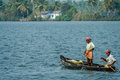 Kerala fishermen two indian fishing in the backwaters india Royalty Free Stock Photos