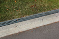 Kerbside and rainwater drainage system in a park Royalty Free Stock Photo