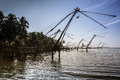 Kerla backwater with chinese fishing net near cochin Stock Photos